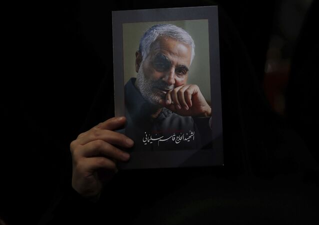 A Hezbollah supporter holds pictures of slain Iranian Revolutionary Guard Gen. Qassem Soleimani during a ceremony marking the anniversary of the assassination of Hezbollah leaders, Abbas al-Moussawi, Ragheb Harb and Imad Mughniyeh and the end of a 40-day Muslim mourning period for Soleimani, in the southern suburb of Beirut, Lebanon, Sunday, Feb. 16, 2020