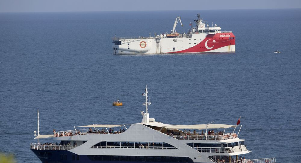 Turkey's research vessel, Oruc Reis, rear, anchored off the coast of Antalya on the Mediterranean, Turkey, Sunday, Sept. 13, 2020. Greece's Prime Minister Kyriakos Mitsotakis welcomed the return of a Turkish survey vessel to port Sunday from a disputed area of the eastern Mediterranean that has been at the heart of a summer stand-off between Greece and Turkey over energy rights.