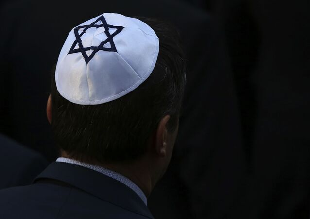 A man wearing a kippah Jewish skullcap arrives at the synagogue in Halle, eastern Germany, on October 10, 2019, one day after the attack where two people were shot dead.
