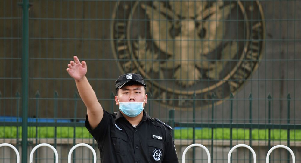 A Chinese security guard gestures outside the US embassy in Beijing on September 12, 2020