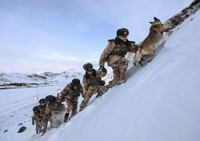 This photo taken on November 21, 2019 shows Chinese People's Liberation Army (PLA) soldiers patrolling along the border of Khunjerab Pass in Kashgar in China's western Xinjiang region.