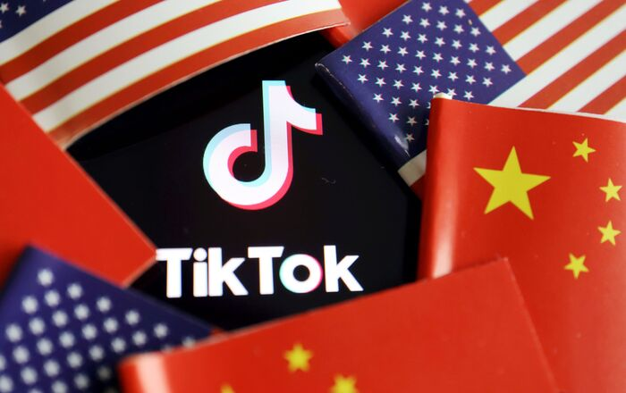 China and U.S. flags are seen near a TikTok logo in this illustration picture taken July 16, 2020. REUTERS/Florence Lo/Illustration