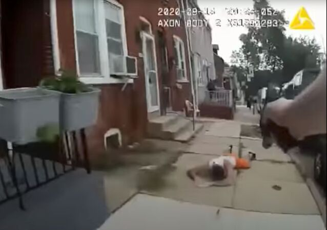 A man lies on the ground after being shot by a police officer in Lancaster, Pennsylvania, U.S., in this still image taken from a body camera footage on September 13, 2020.