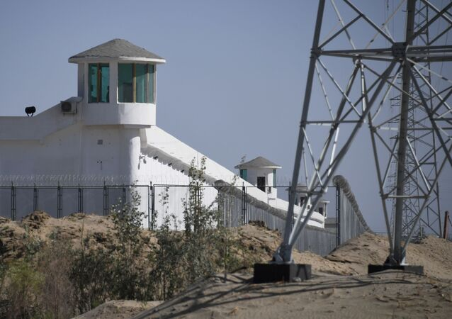 This file photo taken on May 30, 2019 shows watchtowers on a high-security facility near what is believed to be a re-education camp where mostly Muslim ethnic minorities are detained, on the outskirts of Hotan, in China's northwestern Xinjiang region. - The US announced September 14, 2020 it would block a range of Chinese products made by forced labor in the Xinjiang region, including from a vocational center that it branded a concentration camp for Uighur minorities.