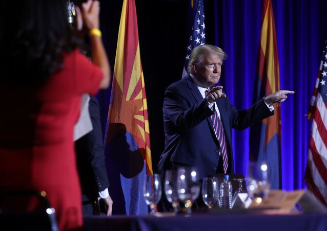 U.S. President Donald Trump gestures during a campaign event at the Arizona Grand Resort and Spa in Phoenix, Arizona U.S., September 14, 2020.