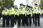 Police officers wearing face masks stand guard during a protest opposed to COVID-19 pandemic restrictions, in Trafalgar Square, London, 29 August, 2020