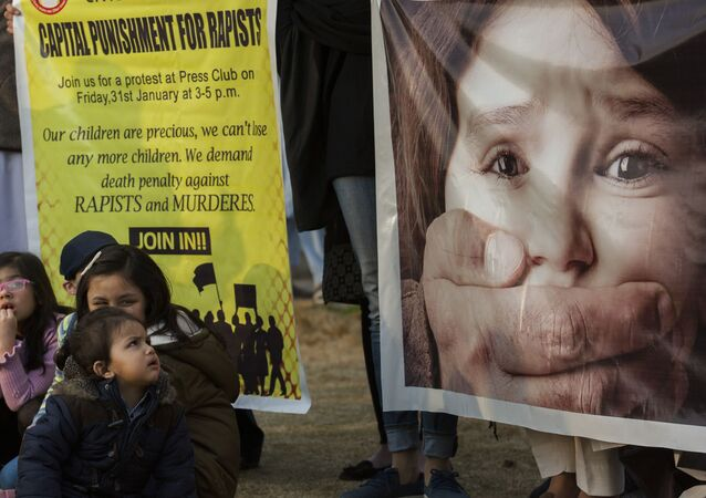 In this 31 January 2020 photo, Pakistani children take part in a rally against child abuse, in Islamabad, Pakistan