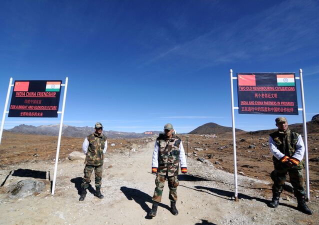 Indian Army personnel keep vigilance at Bumla pass on the India-China border in Arunachal Pradesh on 21 October 2012