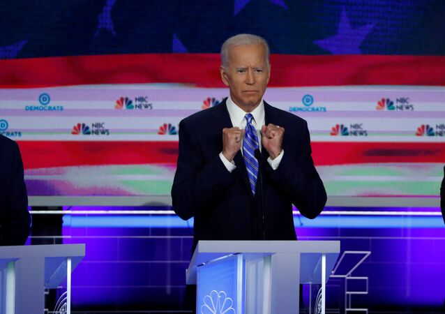 FILE PHOTO: Former Vice President Joe Biden gestures as he speaks during the second night of the first Democratic presidential candidates debate in Miami, Florida, U.S. June 27, 2019