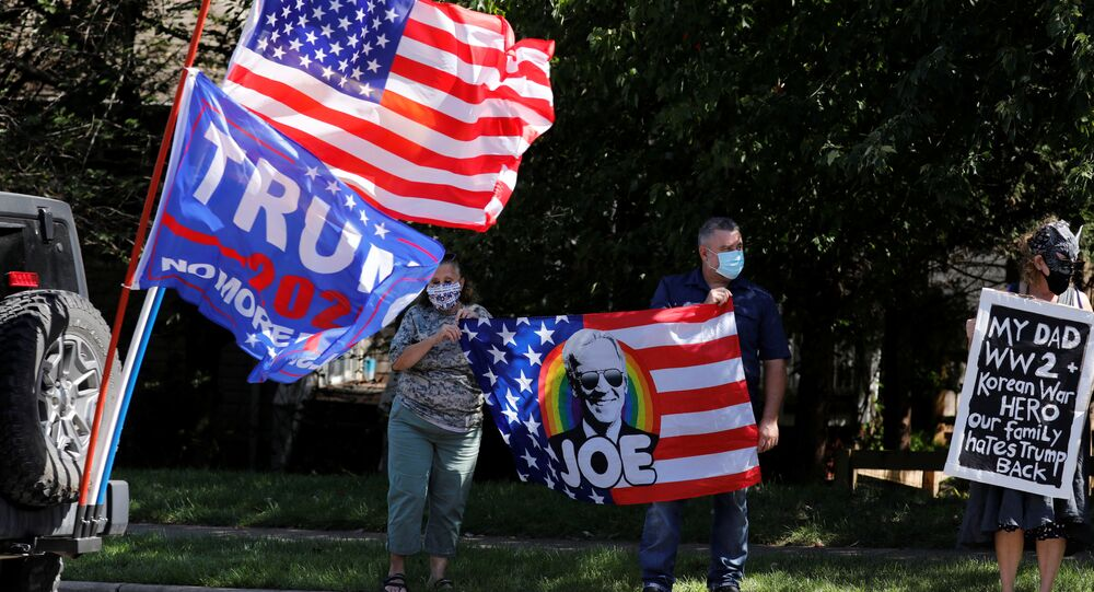 Supporters of U.S. President Donald Trump and Democratic U.S. presidential nominee and former Vice President Joe Biden gather outside while Trump plays golf at Trump National Golf Club in Sterling, Virginia, U.S., September 5, 2020