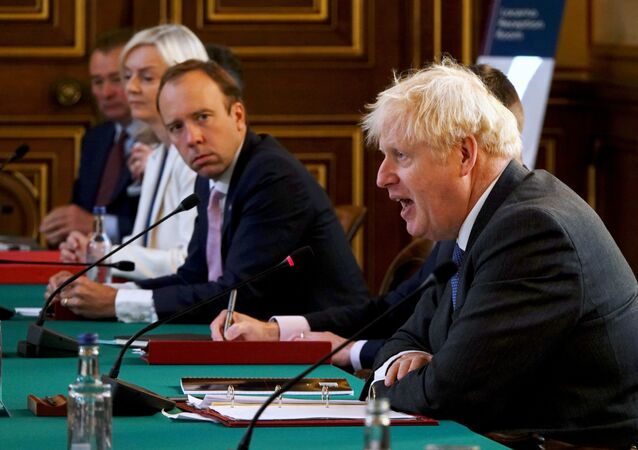 British Health Secretary Matt Hancock looks on as Prime Minister Boris Johnson speaks at a cabinet meeting at the Foreign Office in London, Britain September 15, 2020