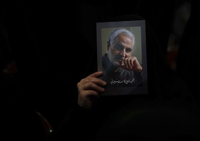 A Hezbollah supporter holds pictures of slain Iranian Revolutionary Guard Gen. Qassem Soleimani during a ceremony marking the anniversary of the assassination of Hezbollah leaders, Abbas al-Moussawi, Ragheb Harb and Imad Mughniyeh and the end of a 40-day Muslim mourning period for Soleimani, in the southern suburb of Beirut, Lebanon, Sunday, Feb. 16, 2020. Nasrallah said U.S. President Donald Trump declared war on the Middle East when the U.S. assassinated Soleimani and when the White House announced its plan to end the Palestinian-Israeli conflict. He called on all to resist U.S. influence and its troops presence.