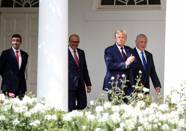 US President Donald Trump applauds as he arrives with United Arab Emirates (UAE) Foreign Minister Abdullah bin Zayed, Bahrain's Foreign Minister Abdullatif Al Zayani and Israel's Prime Minister Benjamin Netanyahu