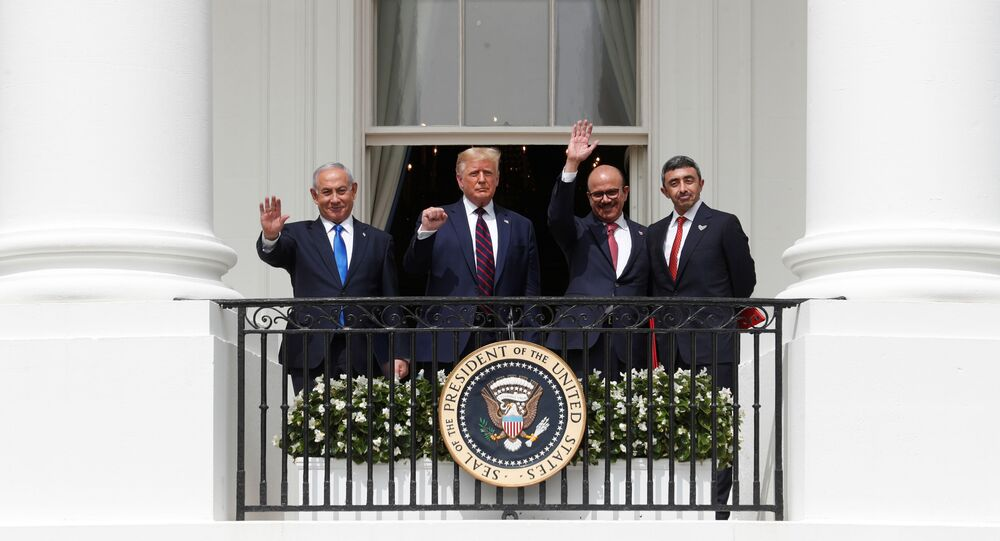 Israel's Prime Minister Benjamin Netanyahu, U.S. President Donald Trump, Bahrain's Foreign Minister Abdullatif Al Zayani and United Arab Emirates (UAE) Foreign Minister Abdullah bin Zayed wave and gesture from the White House balcony after a signing ceremony for the Abraham Accords, normalizing relations between Israel and some of its Middle East neighbors