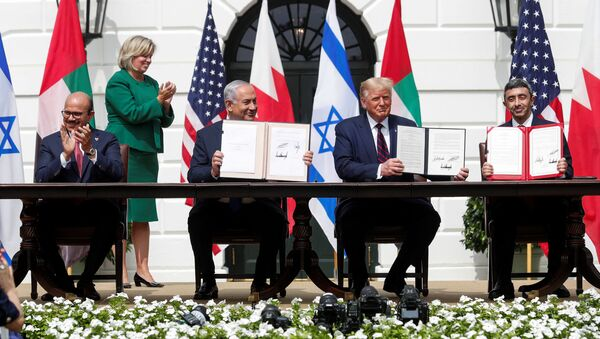 Bahrain's Foreign Minister Abdullatif Al Zayani, Israel's Prime Minister Benjamin Netanyahu, U.S. President Donald Trump and United Arab Emirates (UAE) Foreign Minister Abdullah bin Zayed participate in the signing of the Abraham Accords, normalizing relations between Israel and some of its Middle East neighbors - Sputnik International