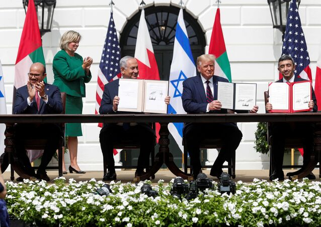 Bahrain's Foreign Minister Abdullatif Al Zayani, Israel's Prime Minister Benjamin Netanyahu, U.S. President Donald Trump and United Arab Emirates (UAE) Foreign Minister Abdullah bin Zayed participate in the signing of the Abraham Accords, normalizing relations between Israel and some of its Middle East neighbors