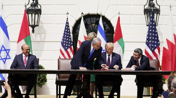 President Donald Trump, center, with from left, Bahrain Foreign Minister Khalid bin Ahmed Al Khalifa, Israeli Prime Minister Benjamin Netanyahu, Trump, and United Arab Emirates Foreign Minister Abdullah bin Zayed al-Nahyan, during the Abraham Accords signing ceremony on the South Lawn of the White House, Tuesday, Sept. 15, 2020, in Washington. (AP Photo/Alex Brandon) - Sputnik International