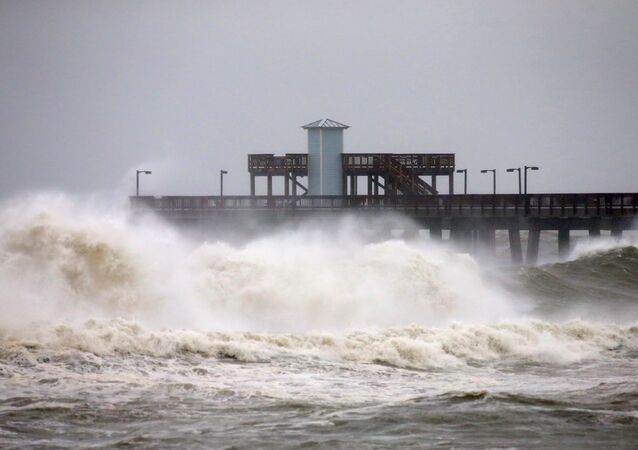 Waves crash along a pier as Hurricane Sally approaches in Gulf Shores, Alabama, U.S., September 15, 2020.