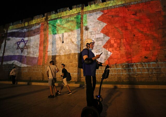 The flags of Israel, United Arab Emirates, and Bahrain are projected on the ramparts of Jerusalem's Old City on September 15, 2020 in a show of support for Israeli normalisation deals with the United Arab Emirates and Bahrain