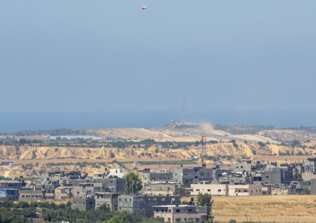 Balloons carrying an incendiary device launched from the Gaza Strip drift to the Israeli side of the border between Gaza and Israel, Monday, Aug. 24, 2020