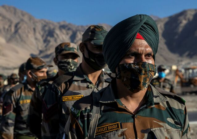 Indian soldiers stand in a formation after disembarking from a military transport plane at a forward airbase in Leh, in the Ladakh region, September 15, 2020