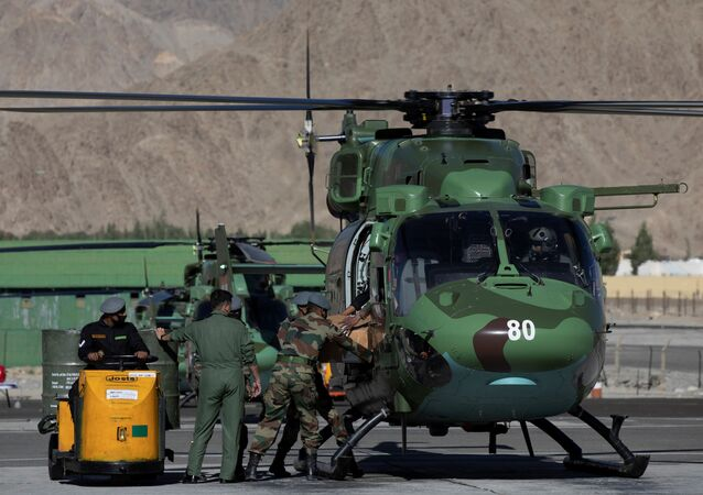 Indian soldiers load supplies on a military helicopter at a forward airbase in Leh, in the Ladakh region, September 15, 2020