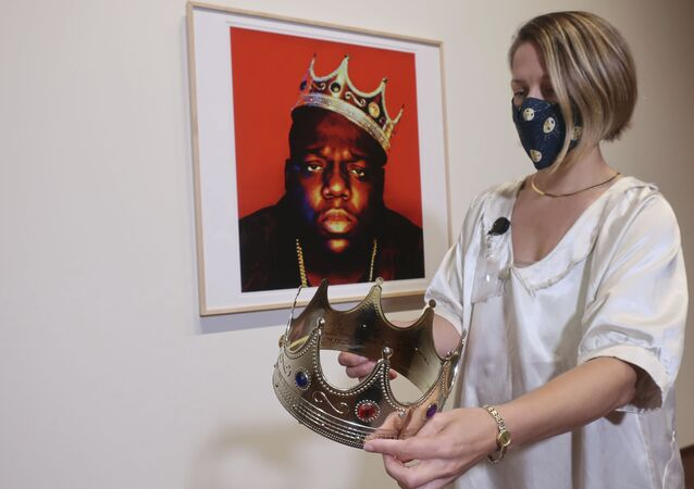 Sotheby's specialist Cassandra Hatton holds the plastic crown worn and signed by the Notorious B.I.G., Monday, Sept. 14, 2020, in New York