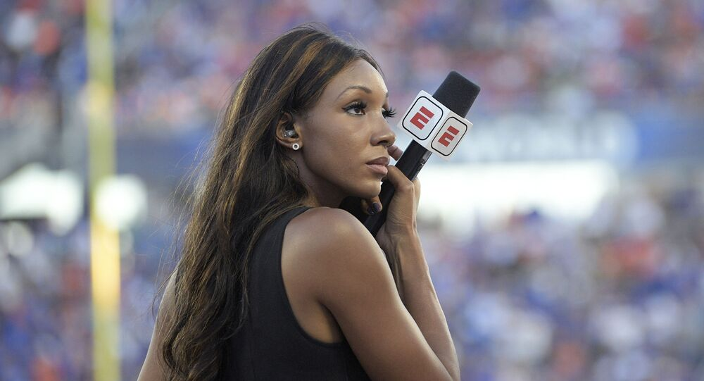 ESPN's Maria Taylor works from the sideline during the first half of an NCAA college football game between Miami and Florida Saturday, Aug. 24, 2019, in Orlando, Fla.