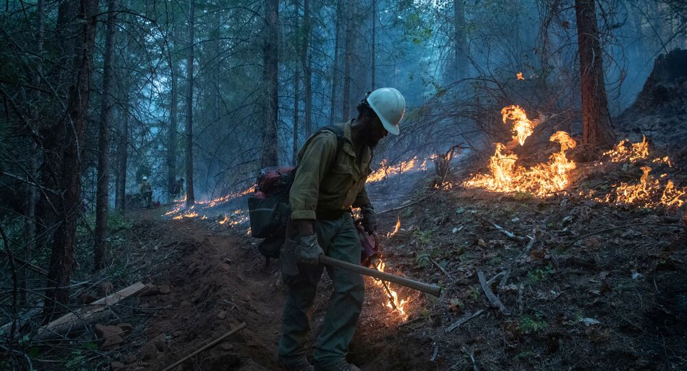 A firefighter from Las Vegas takes part in a firing operation near the Obenchain Fire in Butte Falls, Oregon, U.S., September 15, 2020.