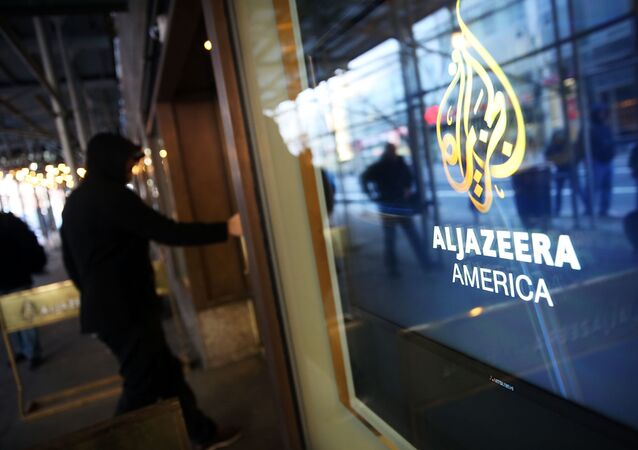 NEW YORK, NY - JANUARY 13: The logo for Al Jazeera America is displayed outside of the cable news channel's offices on January 13, 2016 in New York City. Al Jazeera America, which debuted in August 2013, announced today that they are shutting down.