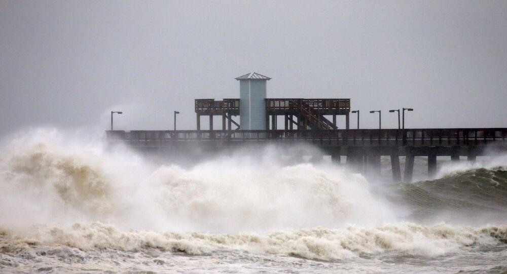 Waves crash along a pier as Hurricane Sally approaches in Gulf Shores, Alabama, U.S., September 15, 2020.