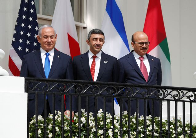 Israel's Prime Minister Benjamin Netanyahu, United Arab Emirates (UAE) Foreign Minister Abdullah bin Zayed and Bahrain's Foreign Minister Abdullatif Al Zayani standby prior to signing the Abraham Accords with US President Donald Trump at the White House, 15 September 2020.