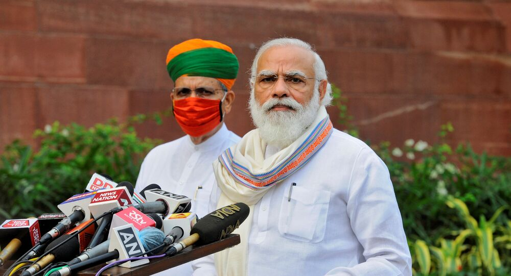 India's Prime Minister Narendra Modi looks on as he speaks to the media inside the parliament's premises on the first day of the monsoon session in New Delhi, India, 14 September 2020