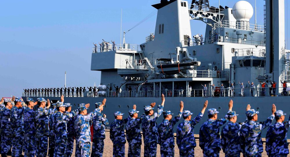 Soldiers of China's People's Liberation Army (PLA) Navy take part in a ceremony as a replenishment ship sets sail to the Gulf of Aden and the waters off Somalia, from a naval port in Qingdao, Shandong province, China 3 September 2020.