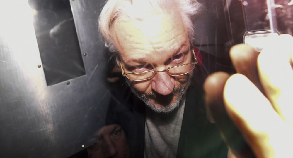Wikileaks founder Julian Assange leaves in a prison van after appearing at Westminster Magistrates Court, for an administrative hearing in London, Monday, Jan. 13, 2020