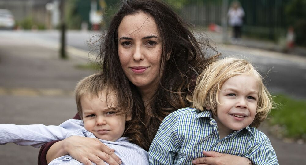 Stella Moris poses for a photo with her sons, Gabriel, right and Max leave Belmarsh Prison after visiting her partner and their father, Julian Assange, in London, Tuesday, Aug. 25, 2020