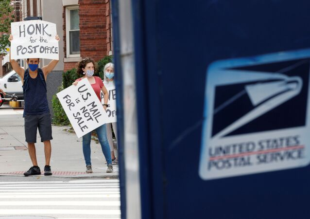 People demonstrate in support of the U.S. Postal Service in Cambridge