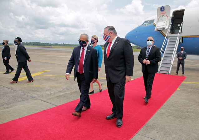 U.S. Secretary of State Mike Pompeo walks with Suriname's Foreign Minister Albert Ramdin, upon his arrival in Paramaribo, Suriname September 17, 2020.