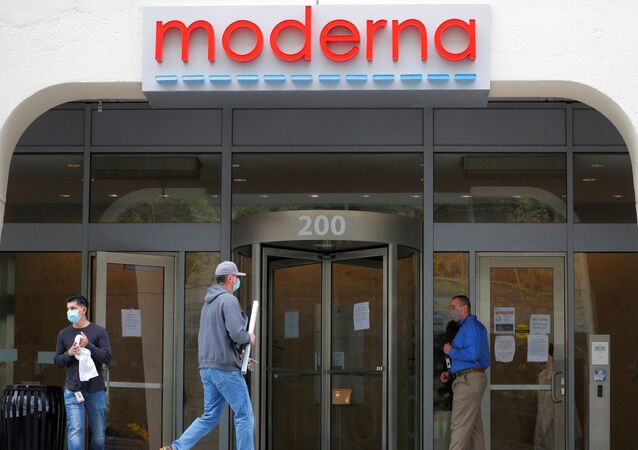 FILE PHOTO: A sign marks the headquarters of Moderna Therapeutics, which is developing a vaccine against the coronavirus disease (COVID-19), in Cambridge, Massachusetts, U.S., May 18, 2020