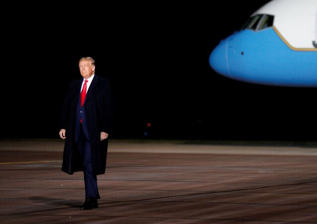 US President Donald Trump walks on the tarmac as he arrives for a campaign event at the Central Wisconsin Airport in Mosinee, Wisconsin, US, September 17, 2020