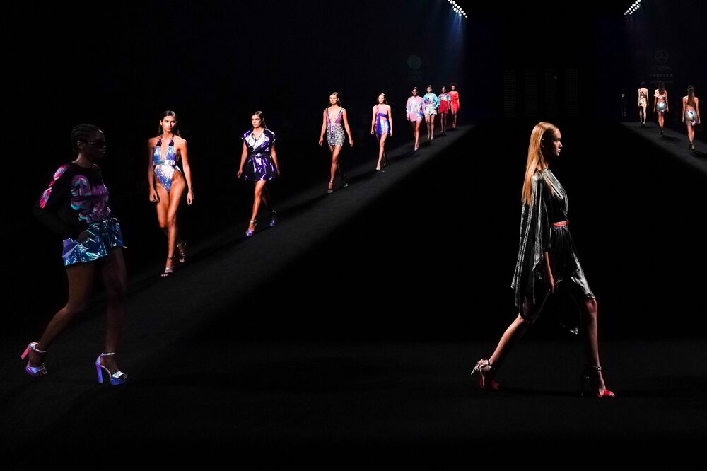 Models present creations by Custo Barcelona during the Mercedes Benz Fashion Week, amid the coronavirus disease (COVID-19) outbreak, in Madrid, Spain, 12 September 2020.