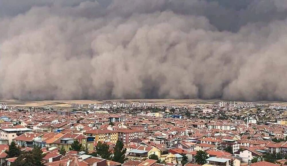A handout TV grab made available by the Demiroren News Agency (DHA) on 12 September 2020, shows a freak sandstorm sweeping over Polatli, in Ankara, on 12 September 2020.  A freak sandstorm hit Ankara on 12 September 2020, the Turkish capital's mayor said, as officials said six people were injured after strong winds.