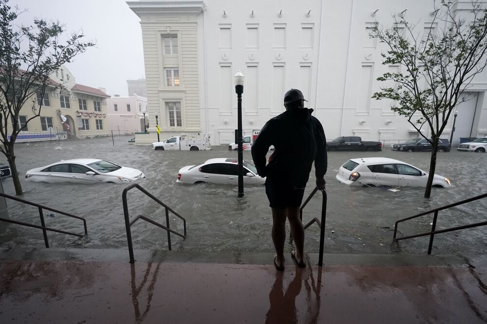 Flood waters move on the street, Wednesday, 16 Sept. 2020, in Pensacola, Fla. Hurricane Sally made landfall Wednesday near Gulf Shores, Alabama, as a Category 2 storm, pushing a surge of ocean water onto the coast and dumping torrential rain that forecasters said would cause dangerous flooding from the Florida Panhandle to Mississippi and well inland in the days ahead.