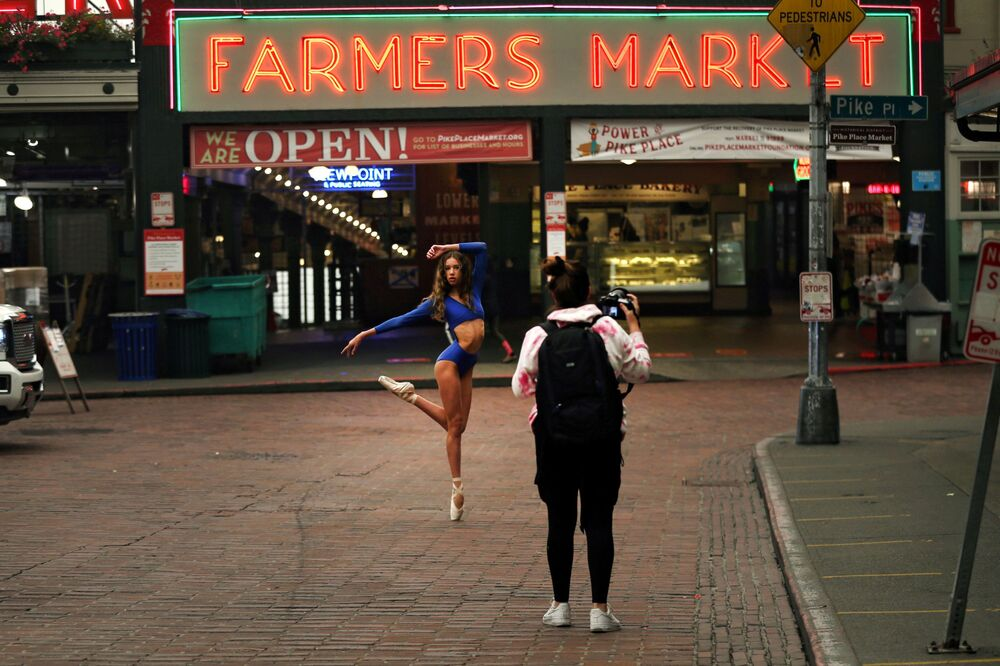 A dancer poses for a photographer at the Pike Place Market in Seattle, Washington, U.S., 12 September 2020.