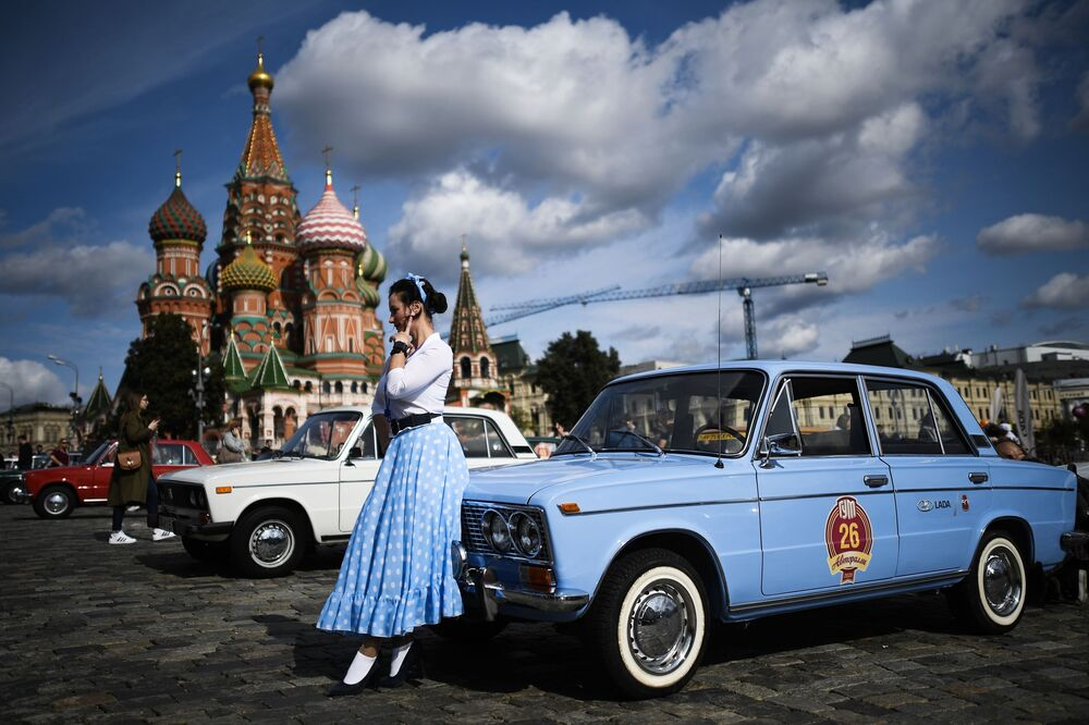 A girl in front of a Zhiguli before the start of the rally of unique cars of the Soviet era GUM Rally 2020