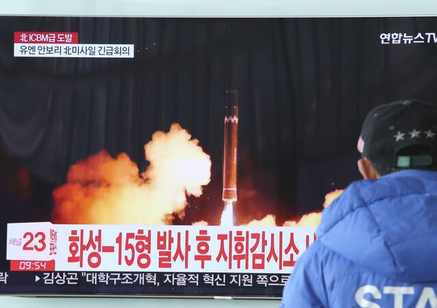 A man watches a TV screen showing what the North Korean government calls the Hwasong-15 intercontinental ballistic missile, at the Seoul Railway Station in Seoul, South Korea, 30 November 2017