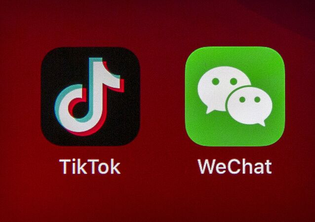 Icons for the smartphone apps TikTok and WeChat are seen on a smartphone screen in Beijing, 7 August 2020