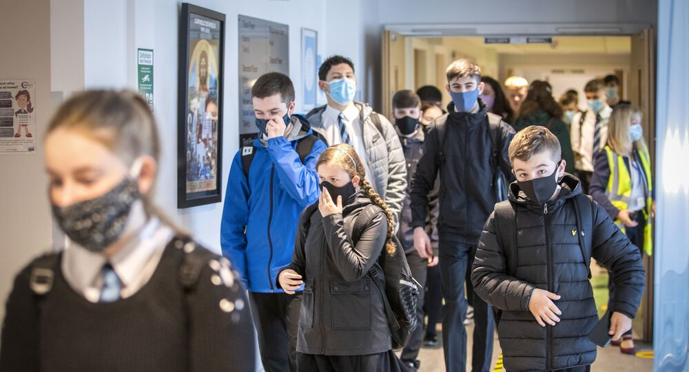 Students at St Columba's High School, Gourock, Scotland, wear protective face masks as the requirement for secondary school pupils when moving around school comes into effect from today across Scotland, Monday Aug. 31, 2020