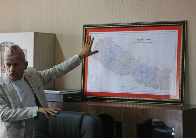 FILE - In this Tuesday, June 9, 2020, file photo, Nepal's Foreign Minister Pradeep Gyawali points to a map of Nepal during an interview with the Associated Press in Kathmandu, Nepal