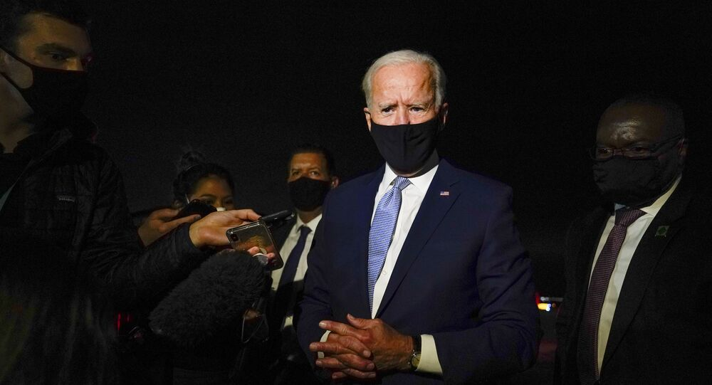 Democratic presidential candidate, former Vice-President Joe Biden talks with reporters at Wilkes-Barre Scranton International Airport, in Avoca, Pa., after a CNN town hall Thursday, Sept. 17, 2020
